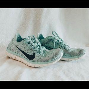 Nike Free 4.0 Flyknit tennis shoes size 7